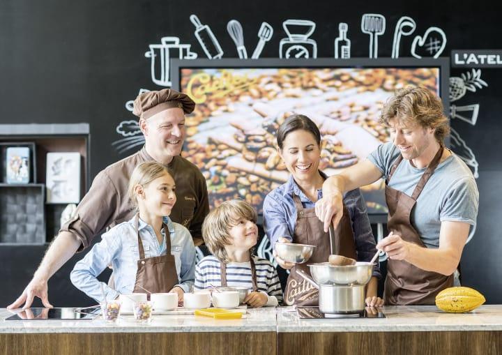Maison Cailler in Broc (Fribourg Region): Chocolatier und Familie. Bild © Maison Cailler